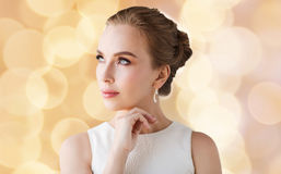 Woman in white with jewelry over holidays lights Royalty Free Stock Photography