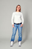 Woman in white jumper and blue jeans Royalty Free Stock Photos