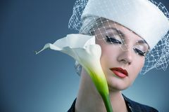 Woman with white kala flower Stock Photos