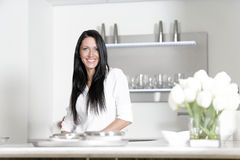Woman in a white kitchen Royalty Free Stock Photos