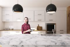 White kitchen, marble countertop, woman. Woman in a white kitchen interior with large windows, a white marble table and a white marble countertop with a sink. 3d Stock Photo