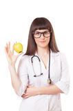 Woman in a white lab coat with apple Royalty Free Stock Photography