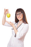 Woman in a white lab coat with apple Stock Photos