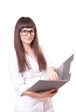 Woman in a white lab coat and glasses Royalty Free Stock Image