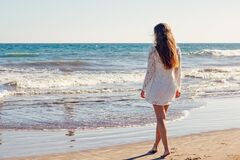 Woman in White Lace Long Sleeves Dress on Seashore Royalty Free Stock Image
