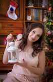 Woman with white lantern under Christmas tree Royalty Free Stock Photo
