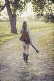 Woman in White Long Sleeve Dress Carrying a Guitar Royalty Free Stock Image