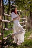 Woman In White Long-sleeved Gown Holding Flower Bouquet Royalty Free Stock Images
