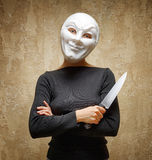 Woman in white mask holding the knife.  Stock Images