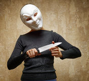 Woman in white mask holding the knife Stock Image