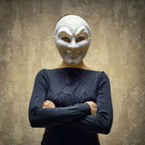 Woman in white mask. Horror concept Stock Photos