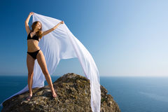Woman with white material and nature Royalty Free Stock Photos