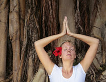 Woman in white meditating Royalty Free Stock Photo