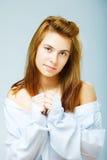 Woman in a white men's shirt Stock Photo