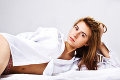 Woman in a white men's shirt Royalty Free Stock Image