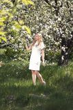 Woman in White Mini Dress Standing on Green Grass Field royalty free stock image