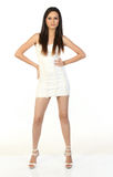 Woman in a white miniskirt. Portrait of a fresh and lovely woman in a white miniskirt Stock Image