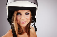 Woman with a white motorcycle helmet Stock Photography