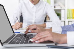 Woman with white nails is typing Stock Photos