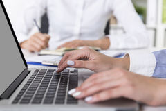 Woman with white nails typing Stock Image