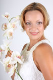Woman with white orchid Royalty Free Stock Photography