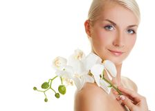 Woman with white orchid Stock Images