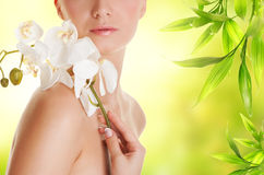 Woman with white orchid flower Stock Image