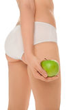 Woman  in white panties with green apple Stock Photo