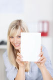 Woman with white paper. Pretty female showing a white empty paper in a close up shot stock photos