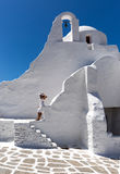 Woman in white at the Paraportiani Church of Mykonos, Greece Royalty Free Stock Image
