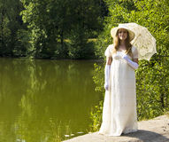 Woman in white in park Royalty Free Stock Image