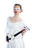 Woman with white party mask on face and white violin in hands Stock Photo