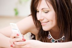 Woman with white phone Royalty Free Stock Image