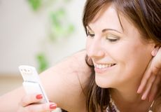 Woman with white phone Stock Photography