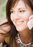 Woman with white phone Royalty Free Stock Images