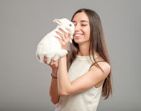 Woman with white rabbit Royalty Free Stock Images