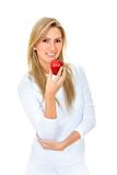Woman in white with a red apple Royalty Free Stock Photo
