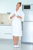 Woman in white robe drinking coffee Royalty Free Stock Images