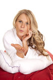 Woman white robe red sheet lay blow kiss Stock Photo