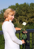 Woman with a white rose stock photography