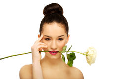 Woman with white rose in mouth. Stock Photography