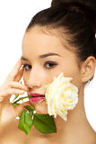 Woman with white rose in mouth. Royalty Free Stock Images