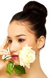 Woman with white rose in mouth. Royalty Free Stock Photography