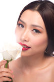 Woman with white rose in mouth. Stock Photo