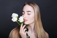 Woman with white roses stock image