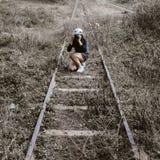 Woman White Round Hat Holding Black Dslr Camera on Rail Way Stock Image