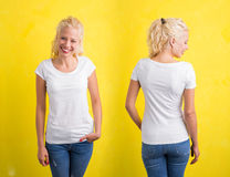 Woman in white round neck T-shirt on yellow background Stock Images