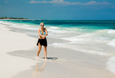 Woman on a White Sand Beach Stock Photography