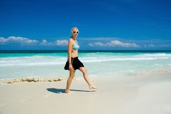 Woman on a White Sand Beach Royalty Free Stock Images
