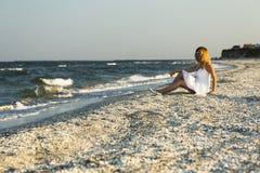 Woman on white sand beach Stock Photos